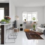 декор черно-белой кухни-гостиной в скандинавском стиле