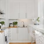 Маленькая белая угловая скандинавская кухня